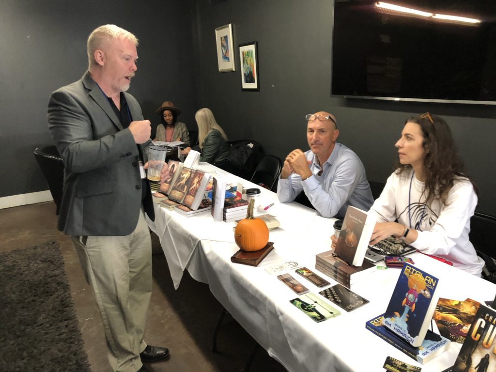 Kevin Grogin, author of 'Black Sheep White Cop: Savannah EXPOsed,' talks with Jack Simmons, author of 'Three Dashes Bitters,' and publisher Leigh E. Rich at the 2019 Savannah Authors Expo.